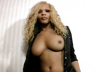 Black tranny with blonde hair stripping wanking and sucking dick