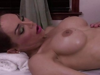 Brunette tranny receives a massage before he fucks her good