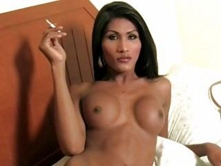 Astonishing tranny with great tits plays with her wiener