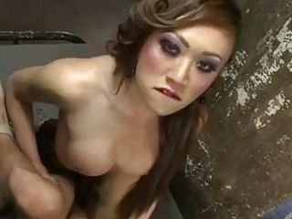 Asian tranny in stockings fucks her man mercilessly