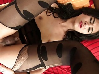 Sexy shemale in lingerie uses her feet on his dick