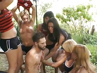 Guy gets gangbanged by a couple of hot soccer shemales