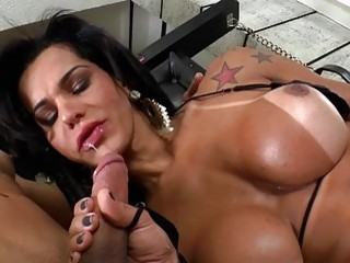 Tattooed tranny takes a big dick deep inside of her