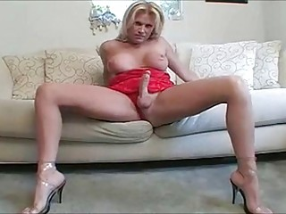 Blonde shemale jerks off until she cums