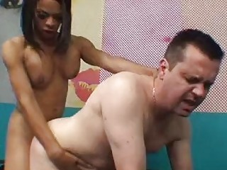 Ebony shemale massages a guy before she fucks his ass